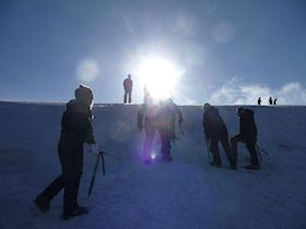 Winter Skills course in the Cairngorms learning to use ice axe and crampons.